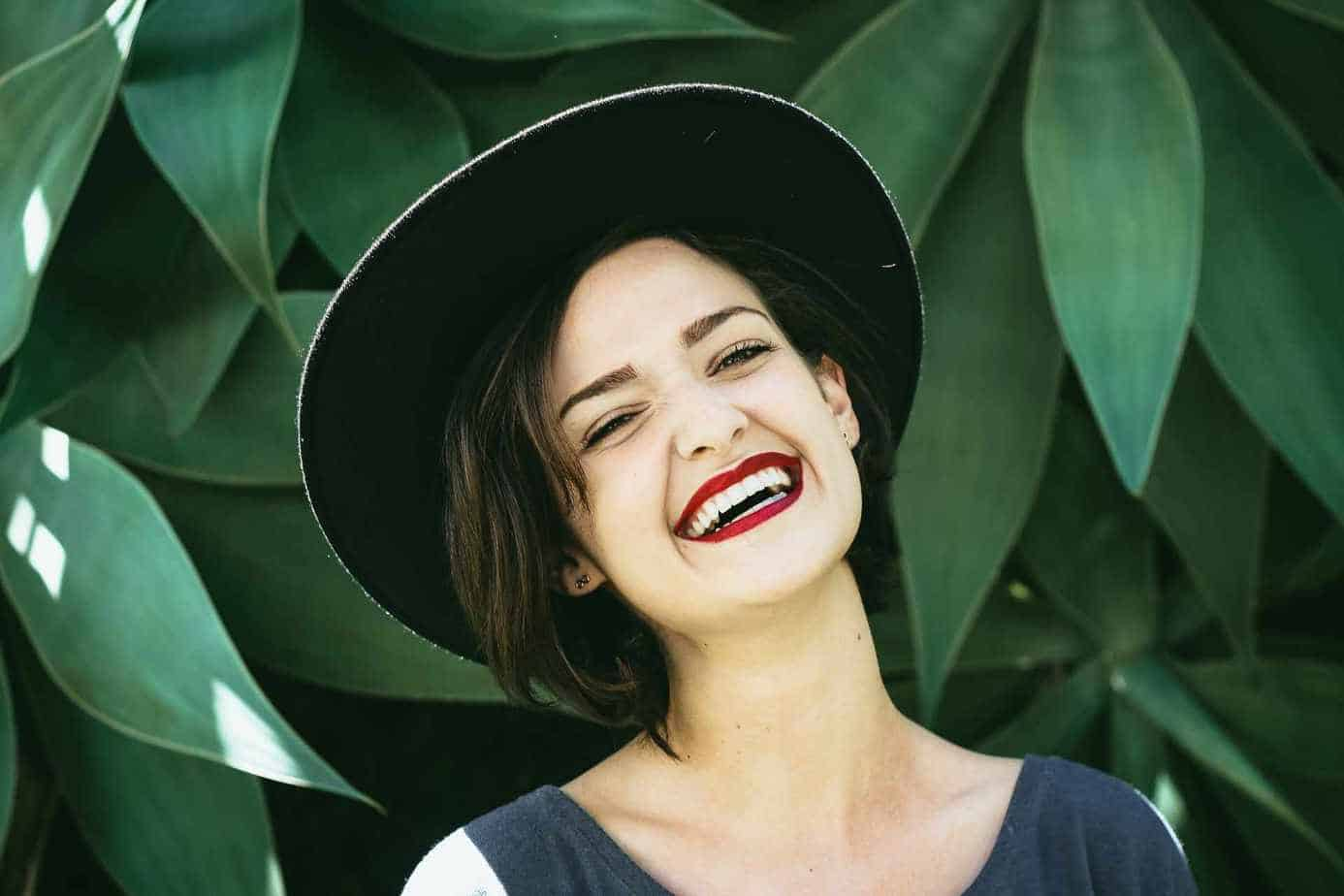 Woman smiles with healthy teeth